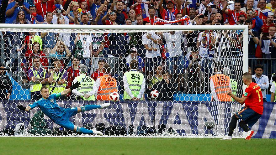 Last 16: Russia's Igor Akinfeev saves a penalty from Spain's Iago Aspas