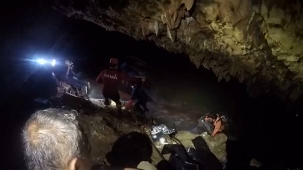 Rescue teams find missing boys, coach in cave with 'signs of life'