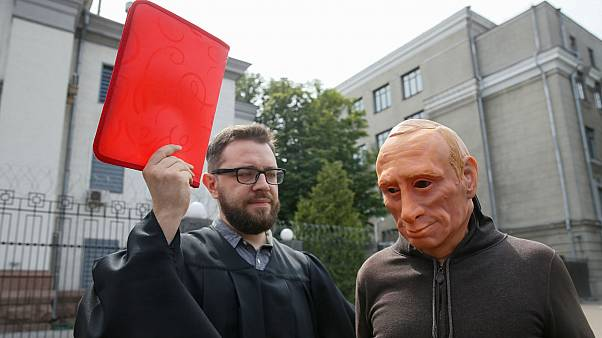 Activists stage a performance in front of the Russian embassy in Kyiv