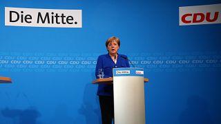 Merkel averts coalition crisis