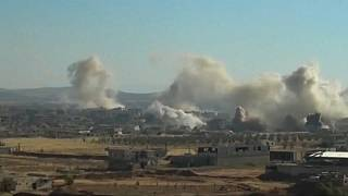 Russian airstrikes help push Syrian rebels back in Deraa province