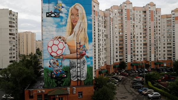 Russian commissions giant mural of his wife with Moscow public funds