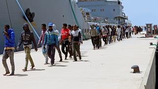 Migrants arrive in Tripoli after being rescued by Libyan coast guards.