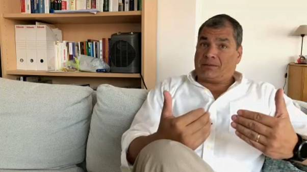 Arrest warrant 'political, illegal and absurd,' says Ecuador's Correa