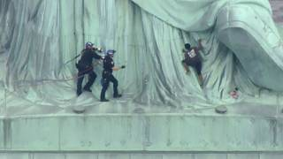 Police seize woman who clambered up Statue of Liberty