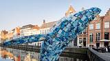 Five tonnes of plastic waste from the sea is transformed into a leaping 12 metre tall whale in Belgium's Bruges canal