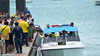 Rescue workers carry a body recovered from the scene