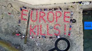 Activists spell 'Europe kills' with life jackets after migrant vessel seized
