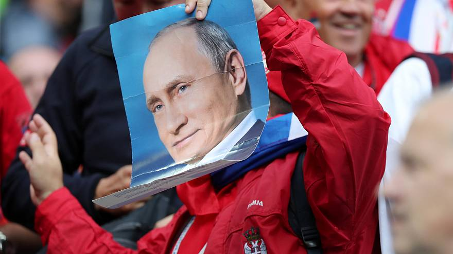 Where's Putin? Serbia fan holds a photo of the Russian leader at World Cup