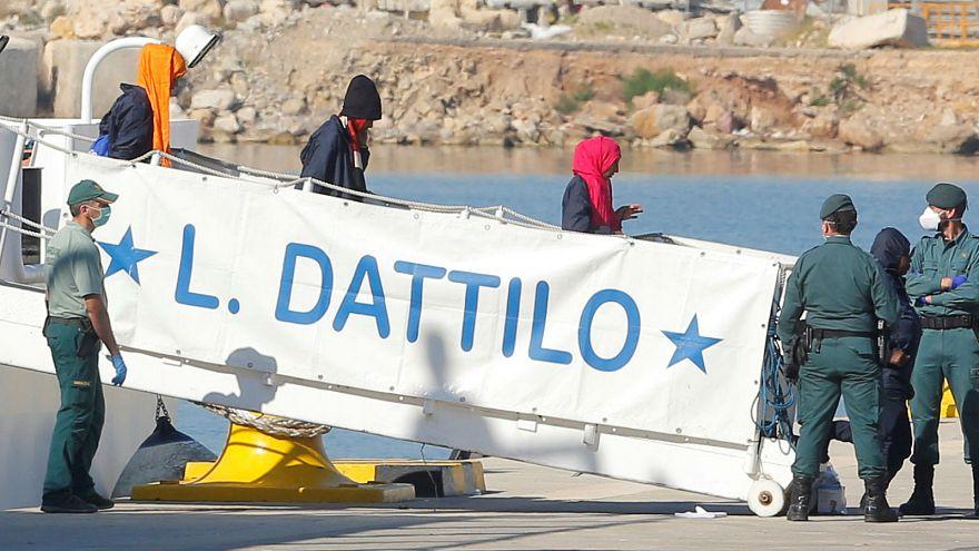 Italian coast guard intervenes in migrant rescue 'to save crew'