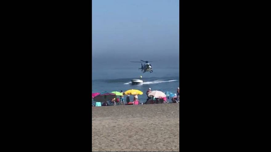 Watch: Police helicopter chases drug smuggler onto Spanish beach