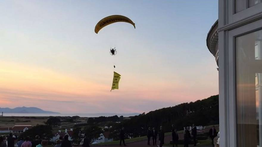 Trump 'well below par': paragliding protester flies over Scotland resort