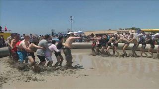 Revellers jump into sludge at South Korea's annual mud festival