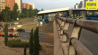 bus is hanging from the bridge in Madrid