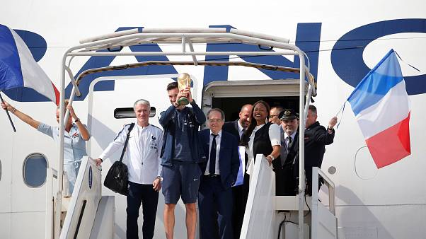Les Bleus touch down in Paris for victory parade