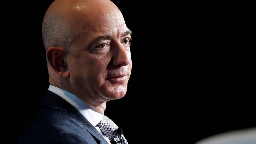 Jeff Bezos becomes 'richest in modern history' as Amazon workers strike