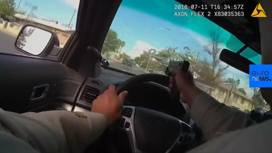Watch: Officer fires through window in Las Vegas car chase