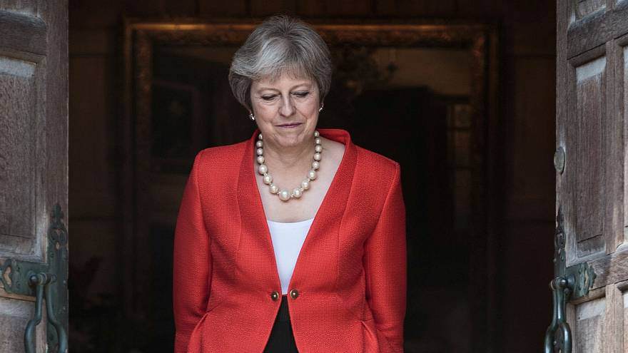 UK's May narrowly avoids defeat on EU customs union