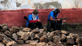 Partidarios del gobierno de Ortega tras los enfrentamientos en Monimbó.