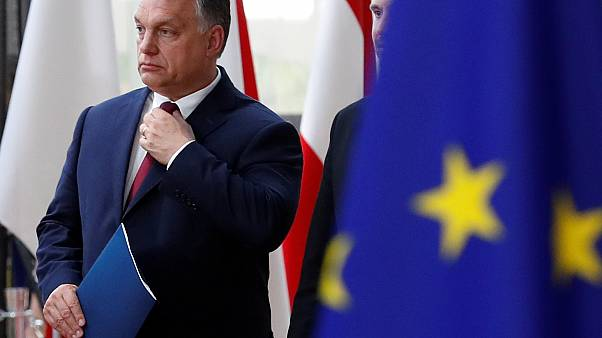 EU steps up battle with Hungary over migration and asylum