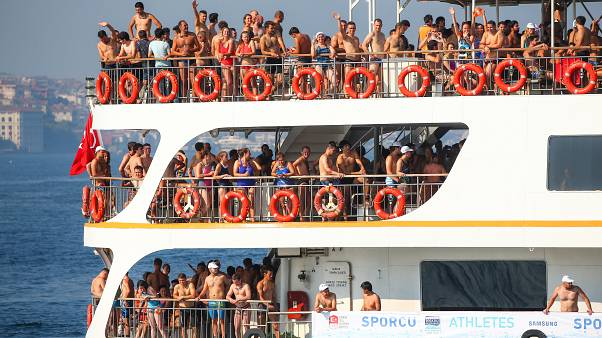 Swimmers race from Asia to Europe across Turkey's Bosphorus Strait