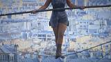 Hanging by a thread: Tightrope walker achieves 35m high stunt in Paris