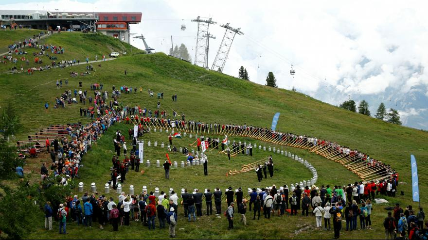 World's biggest alpine horn festival delights Swiss folklore fans