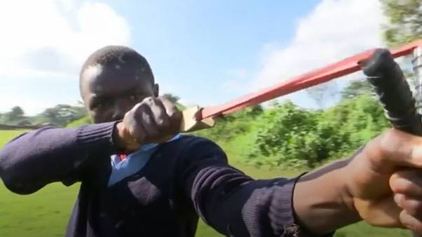 Boys in Kenya use slingshots to plant tree seeds