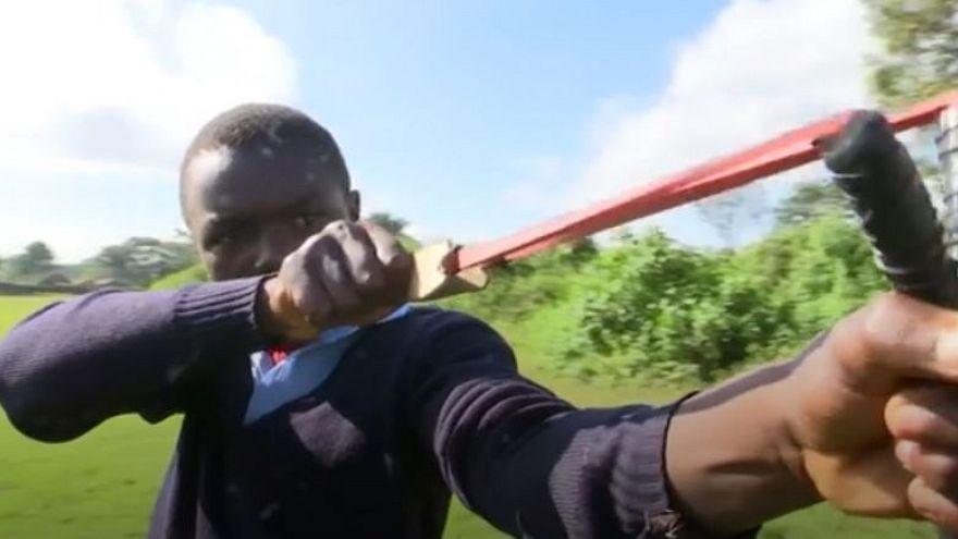 Boys in Kenya use slingshots to plant tree seeds
