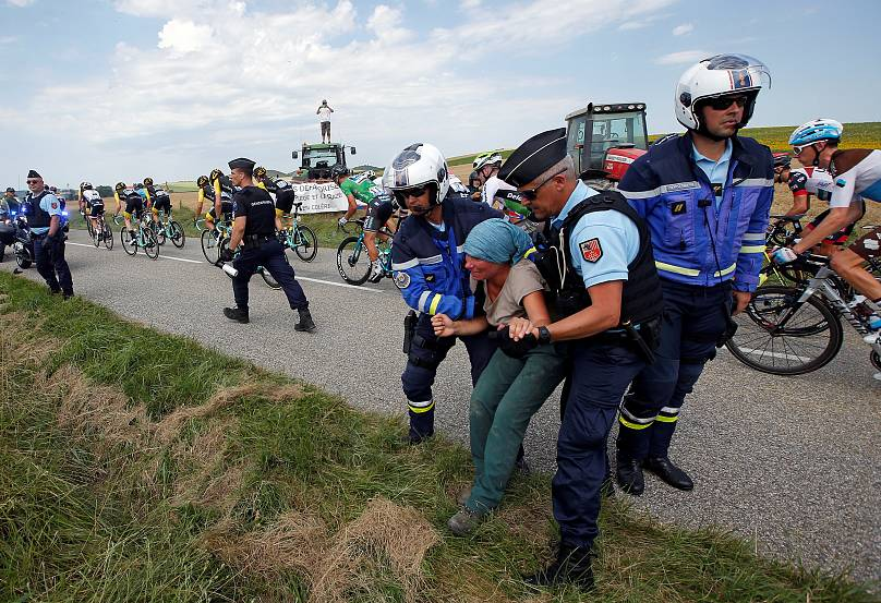 Cyclists hit with spray as Tour halted by protests