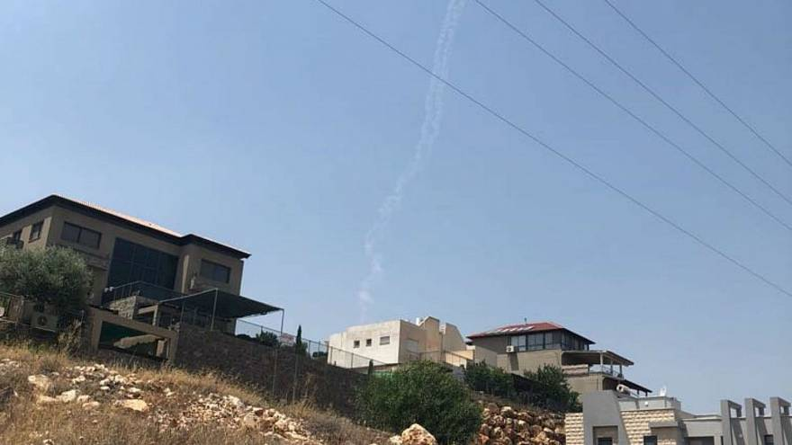 Smoke trails left by Israeli missiles near the city of Safed