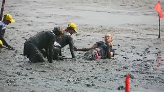 Athletes get down and dirty in mud Olympics
