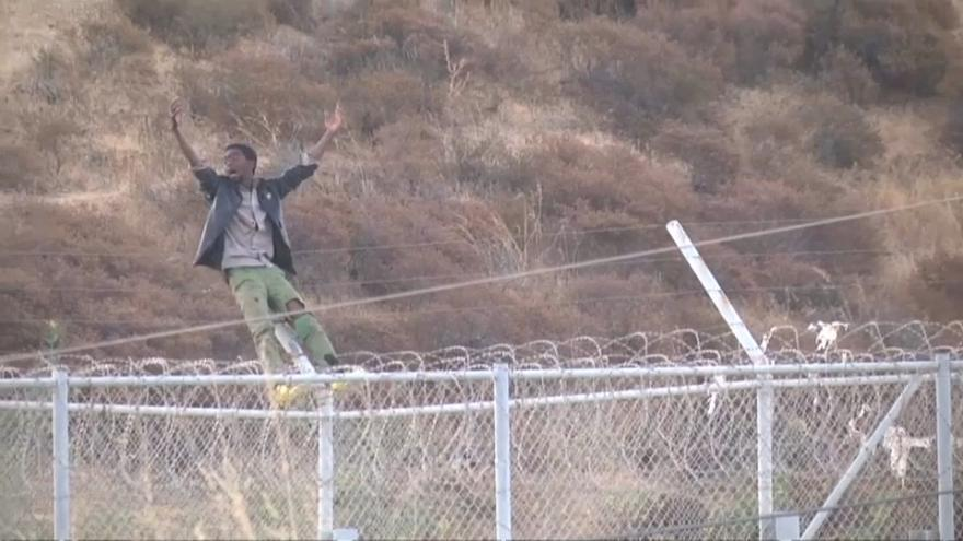 Migrants storm fence at Spain's Ceuta enclave
