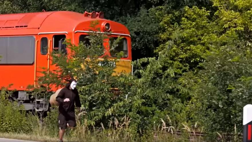 Man races against 'snail train' to prove his point