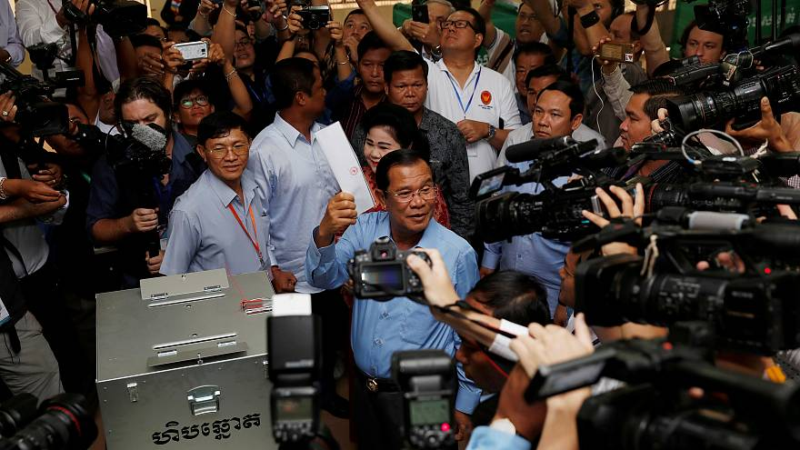 Cambodia's ruling party claims victory after disputed election