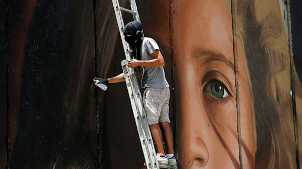 Israel releases Italian street artist arrested over mural of Ahed Tamimi