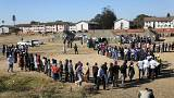 Voters queue to cast ballots in Harare, 30 July 2018