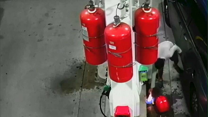CCTV shows man sparking gas station fire