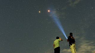 Mars alongside the lunar eclipse