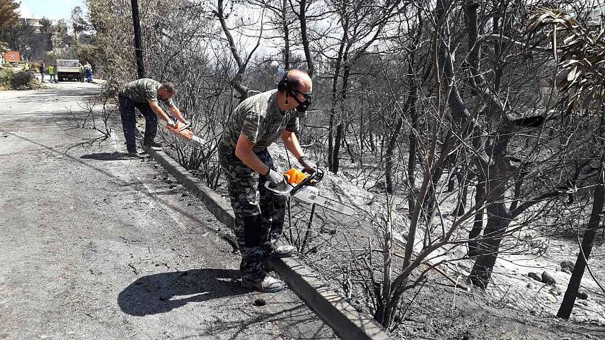 Experts warn of more risks for fire-stricken areas of Greece