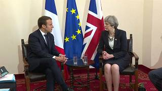 Theresa May tries to sell Brexit to Macron
