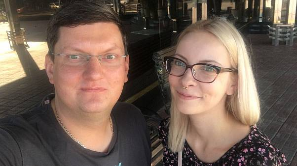 Maria Motuznaya (R) with her lawyer Alexey Bushmakov (L)