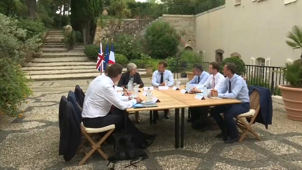 Working holiday: Macron meets May for Brexit talks at his summer residence