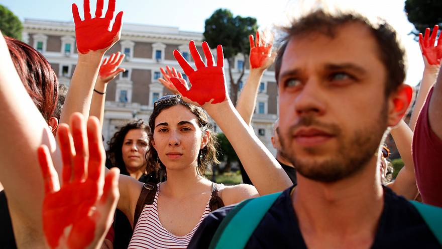 Protesters during a rally against Italy's Interior Minister Matteo Salvini
