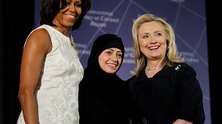 Samar Badawi pictured with Michelle Obama and Hillary Clinton
