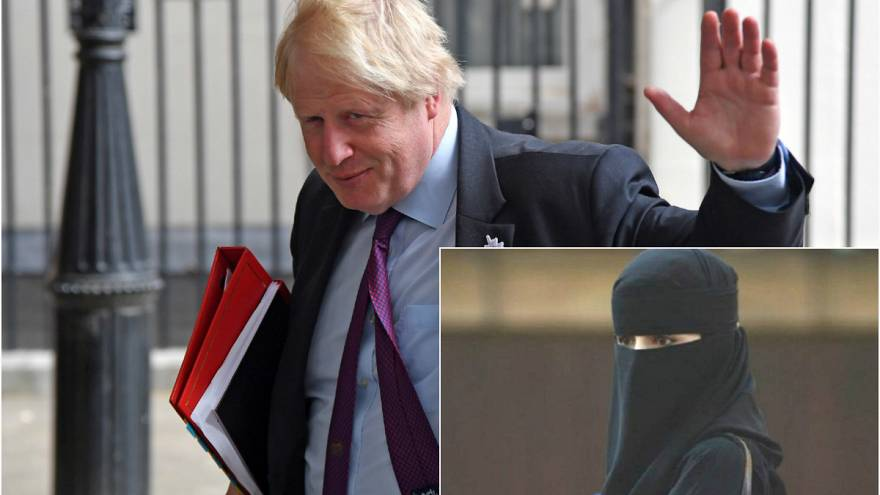Britain's Foreign Secretary Boris Johnson waves as he leaves Downing Street