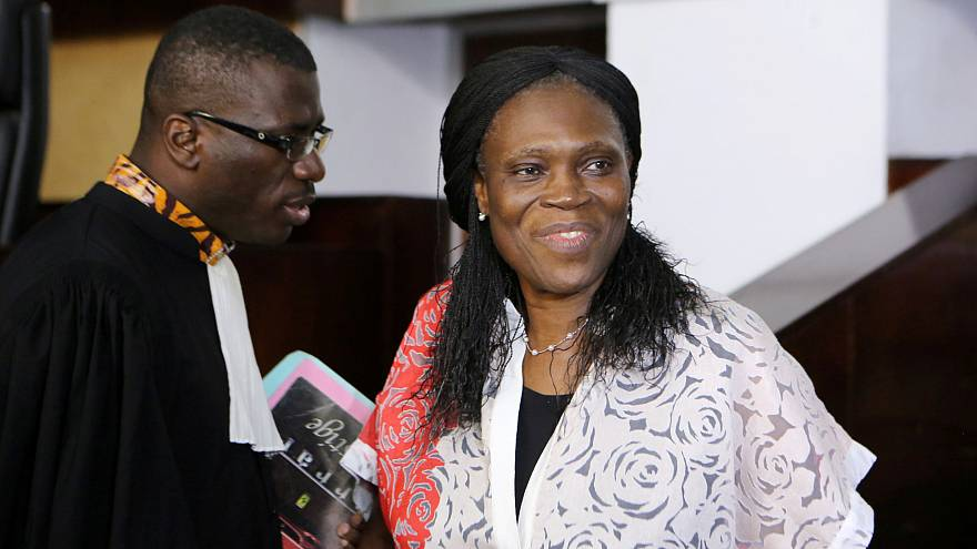 Ivory Coast's former first lady Simone Gbagbo (R), who is accused of crime