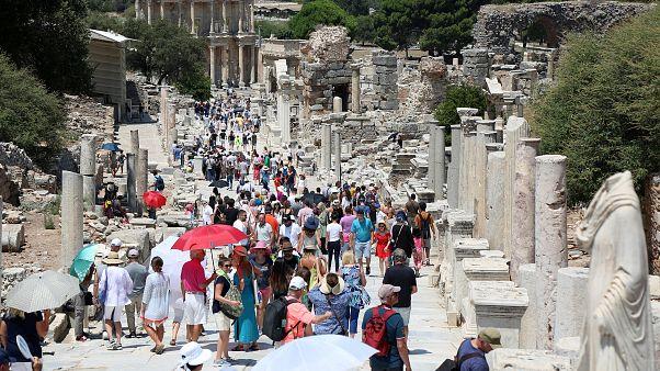 Tourists visit the ancient city of Ephesus near Izmir in Turkey