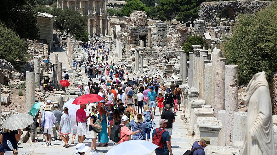 Tourists visit the ancient city of Ephesus near Izmir in Turkey