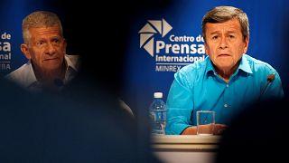 Pablo Beltran, representante del ELN, y Aurelio Carbonell, negociador del E